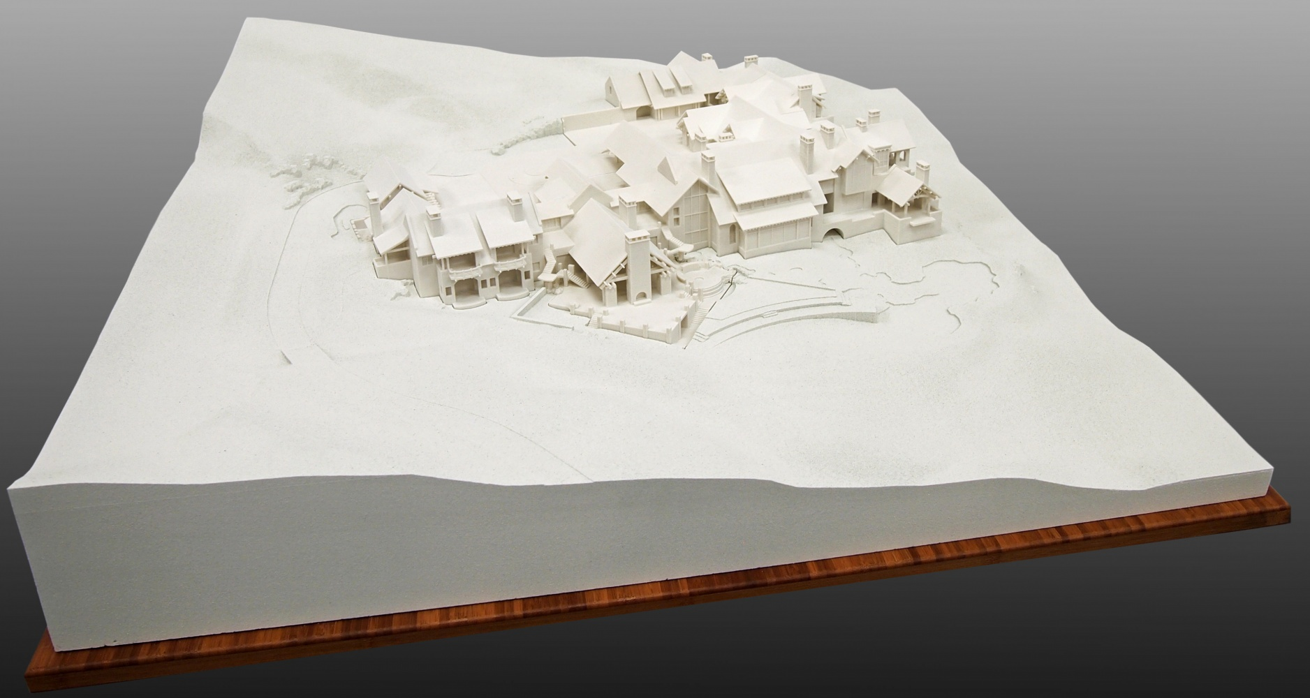 Multiple 3D Prints of a home set in to Milled Terrain Form
