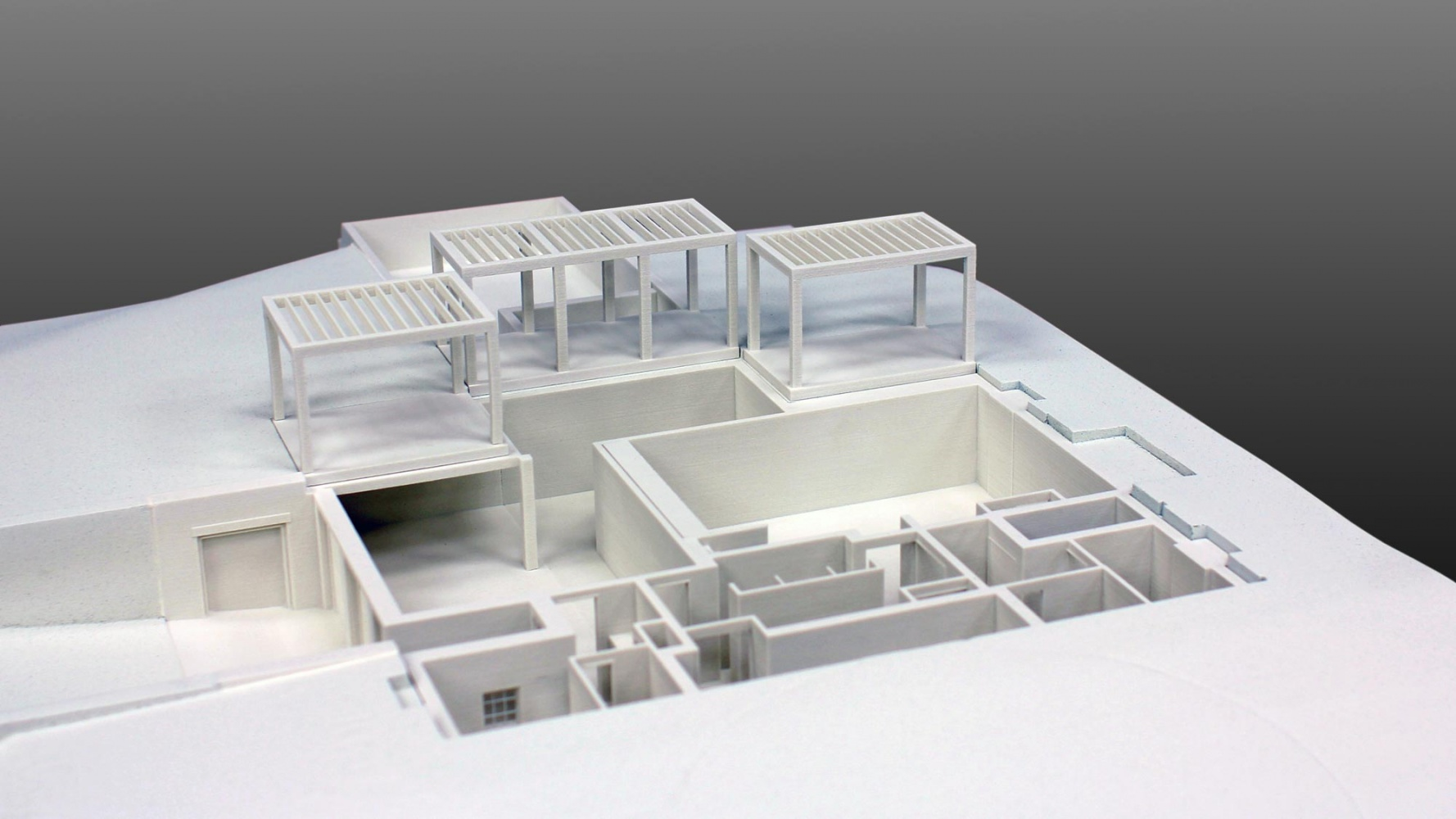 Quarter scale take-apart residential model, 3D printed from ArchiCAD geometry. The window details were laser cut and integrated with the building 3D prints. The site was CNC machined to accept the 3D prints.